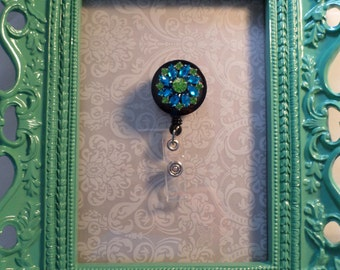 Blue and green name badge reel