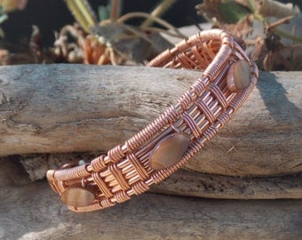 Wire wrapped bracelet with brown rocks