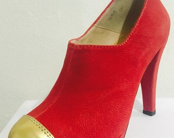 Shoe heel red and gold