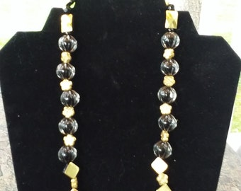 Black and gold beaded necklace.