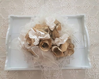Centerpiece with paper flowers with printed text
