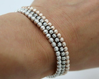Super cute 3fold sterling silver stretch bracelet in rose, gold and rhodium plated
