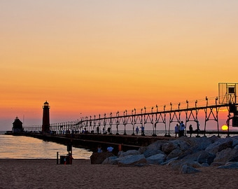 Grand Haven, Michigan lighthouse and pier at sunset