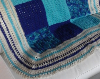 Beautiful Granny Square style blue and tan afghan.