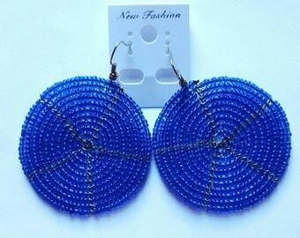 Dark blue beaded spiral earrings