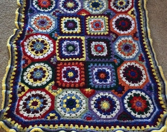 Afghan full of shapes and colors
