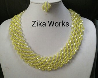 crystal white and yellow necklace and earrings