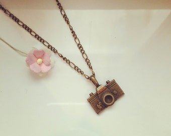 Camera on long chain, photography, image, memory, camera