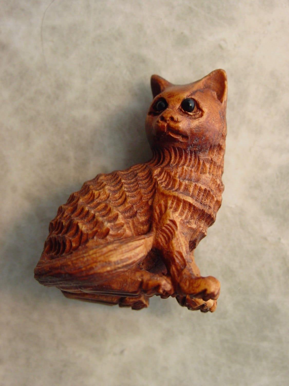 Carved boxwood cat bead from whitewolftradingco on etsy studio