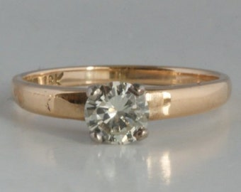18 ct gold solitaire diamond ring 0.69 kt SI1/I-J incl. valuation report/18 ct gold ring 0.69 ct diamond SI/I-J/750 or bague 0.69 diamond