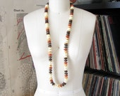 ombre necklace . 1970s plastic bead necklace in burnt orange, cream, brown . long beaded necklace . brown bead necklace . boho 70s jewelry