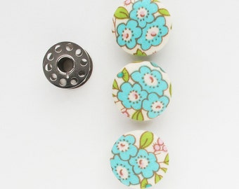 Fabric Covered Buttons 1 Inch | Three 25mm shank back buttons covered in a pretty turquoise floral print cotton fabric.