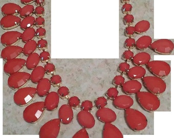 VINTAGE Tear Drop deep orange lucite bib necklace in 3 rows in gold tone