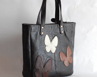Brown leather tote bag with butterflies