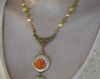 A Rose in Time - Vintage Watch, Carved Coral Rose, Heart Locket Recycled Assemblage Steampunk Necklace