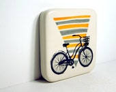 tile with a lady's bike on a triangle shape made up of orange and storm grey stripes, Made to Order.