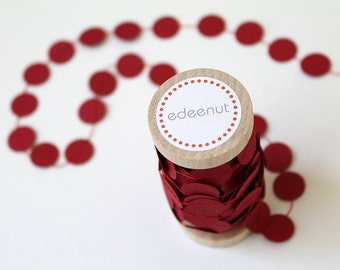 Red Cake Bunting. Paper circle shapes. Party cake topper. Wedding invite cards announcements, save the date. wooden spool of wrapping ribbon