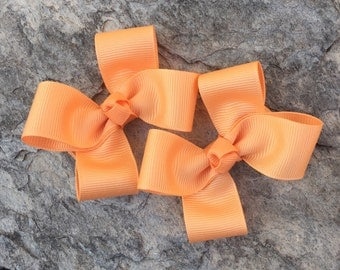 Pair of Orange Cream Clippies