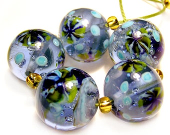 Hand made lampwork rounds in blue with murrini flowers