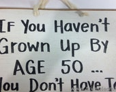 If you haven't grown up by age 50 You don't have to sign OVER the hill gag birthday gift