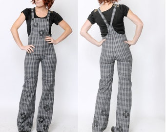 Grey womens overalls, Tight-fitting plaid patterned slacks with black paint, Black flowers, Grey tartan, Gray plaid overalls