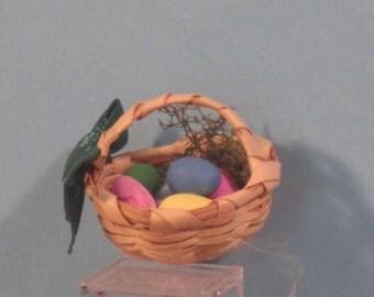 Miniature basket of colored eggs