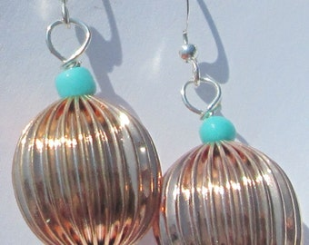 fluted gold tone metal beads with turquoise beads pierced dangle hand made wire wrapped earrings by Ziporgiabella