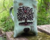 Triumphant Heart Tree Tripod Mug in Turquoise