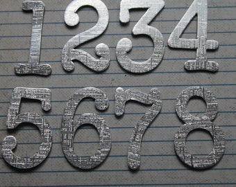 1 3/4 inch tall Numbers 1-12 silver glossy linen textured cardstock die cuts great for wedding table numbers