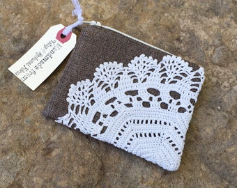 sepia brown change purse with vintage doily