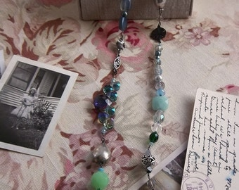 Beaded crystal and freshwater pearl necklace featuring the colors of the ocean