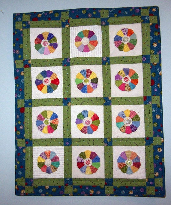 Dresden plate doll quilt wall hanging with crocheted flowers