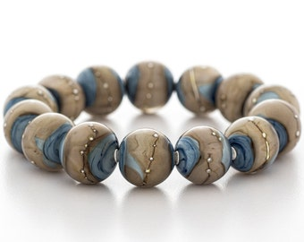blue glass bracelet with sterling silver, stretch style, artisan lampwork jewelry