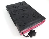 Journal with hand cut spring flowers, recycled bicycle inner tube, handmade blank, medium. Velcro closure,yellow linen.