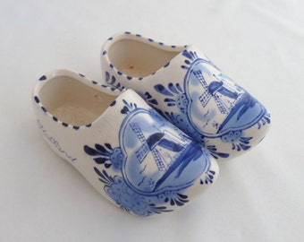 "Ceramic wooden shoes, Dutch souvenir, souvenir of Holland, 2"" x 5"" each, Blue and white, windmills handpainted, marking on bottom"