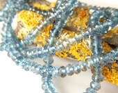 London Blue Topaz Faceted Roundels - Half Strand - 3-3.5mm - 4.5 Inches