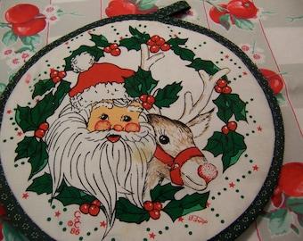 santa and rudolph hot pad