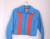 Vintage ladies ski jacket by Skyr orange and blue size small