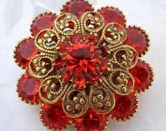 vintage prong set hyacinth orange machine cut crystal rhinestone gold tone flower brooch - j5950