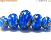 ON SALE 30% OFF Five Sky Blue Treasures Graduated Rondelle Beads 10413611 - Handmade Glass Lampwork Beads
