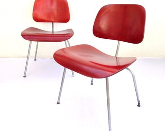Pair of Red Aniline Charles Eames DCM Herman Miller Chairs