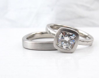 Cushion cut Forever One moissanite and palladium  tapered band solitaire low profile engagement ring