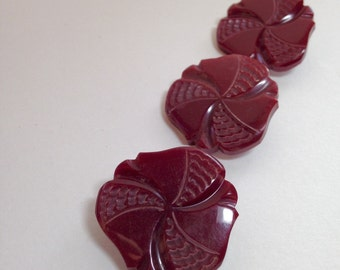 Set of Three Very Beautiful Carved Bakelite Buttons in Burgandy or Wine Color