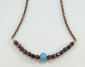 short simple dark red and blue Czech glass and natural brass necklace by CURRICULUM