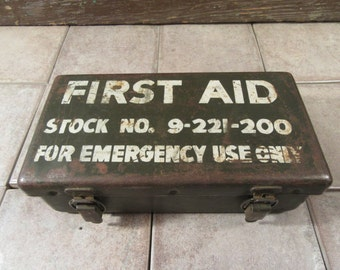 Vintage metal military first aid kit- Stock No. 9-221-200- contains some medical supplies, solid, functional, some surface wear