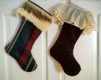 Pair of Christmas stockings with deep red or burgundy and cream colors.