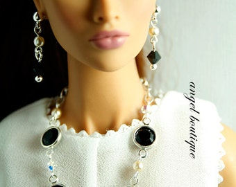 Delicate Long Necklace Links with Black Swarovski Crystal and Glass Pearl. Set Completes with Matching Earrings.