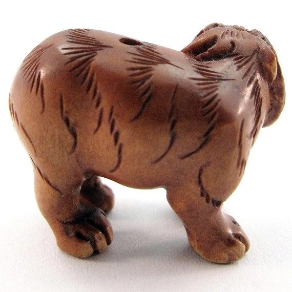 Standing tiger hand carved boxwood ojime quot bead from