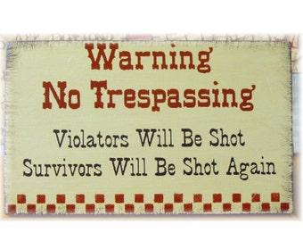 Warning No Trespassing Violators will be shot survivors will be shot again primitive sign