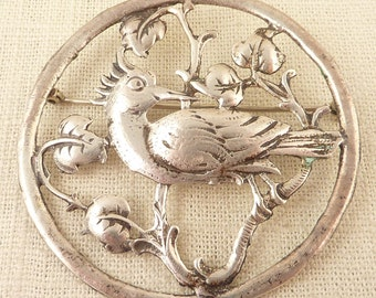 SALE ---- Round Antique Sterling Tropical Bird Cutout Brooch